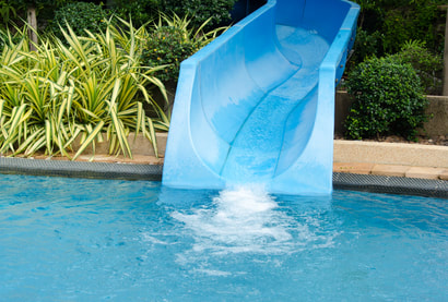 This is a picture of a swimming pool slide in a clean pool in Amarillo, Texas.