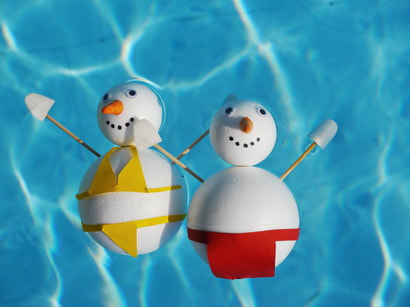 This is a picture of two snowmen in a pool to discuss pool winterization in Amarillo, Texas.